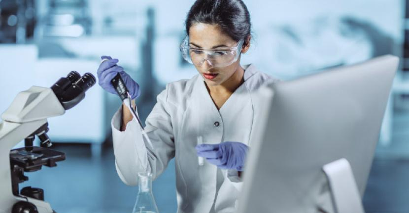 Woman using a chemistry tools